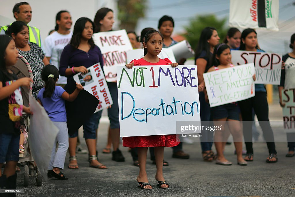 Alisa Ramirez holds a sign reading 'Not 1 More Deportation' as she and others participate in a rally calling on President Barack Obama to immediately suspend deportations and for Congress to pass an immigration reform that's inclusive of all 11 million undocumented people in the U.S. on May 11, 2013 in Homestead, Florida. The rally is part of what is being called a rolling fast in different places throughout the nation over the course of the next two months to bring what organizers say is a moral, prophetic voice to the immigration debate.