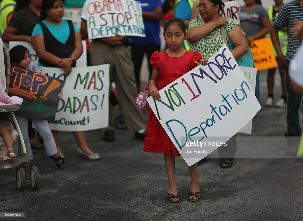 Alisa Ramirez holds a sign reading 'Not 1 More Deportation' as she and others participate in a rally calling on the President Barack Obama to immediately suspend deportations and for Congress to pass an immigration reform that's inclusive of all 11 million undocumented people in the U.S. on May 11, 2013 in Homestead, Florida. The rally is part of what is being called a rolling fast in different places throughout the nation over the course of the next two months to bring what organizers say is a moral, prophetic voice to the immigration debate.