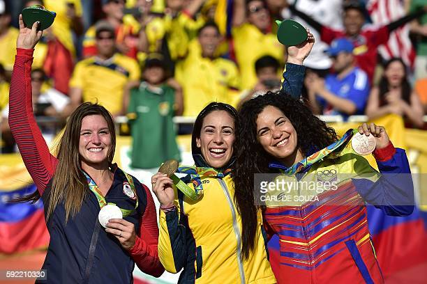 US Alise Post Colombia's Mariana Pajon and Venezuela's Stefany Hernandez celebrate on the podium of the women's BMX cycling event of the Rio 2016...