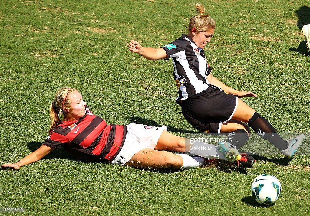 Alisha Bass of the Wanderers tackles Alisha Foote of the Jets during the round six W-League match between the Western Sydney Wanderers and the Newcastle Jets at Campbelltown Sports Stadium on November 25, 2012 in Sydney, Australia.
