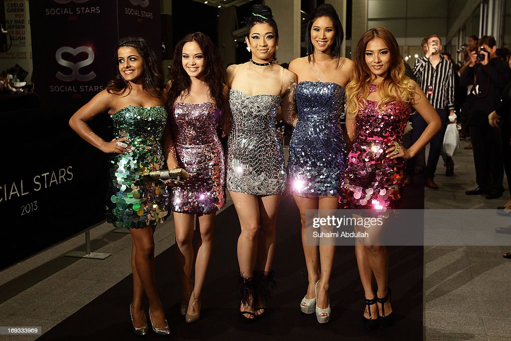 Alisha Budhrani, Angeli Flores, Natsuko Danjo, Victoria Chan and Ji Hae Lee of the girl group Blush pose for photographers on the red carpet during the Social Star Awards 2013 at Marina Bay Sands on May 23, 2013 in Singapore.