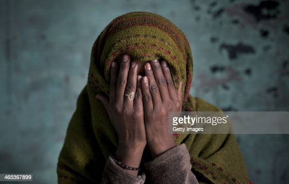 Alishba covers her face while sitting for a photo January 22 2014 in the Shamli District of Uttar Pradesh India According to her she was gang raped...