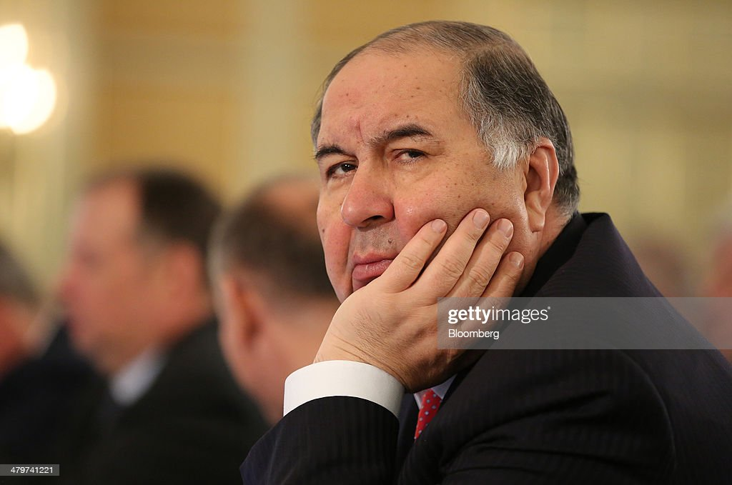 <a gi-track='captionPersonalityLinkClicked' href=/galleries/search?phrase=Alisher+Usmanov&family=editorial&specificpeople=5595265 ng-click='$event.stopPropagation()'>Alisher Usmanov</a>, Russian billionaire and owner of USM Holdings Ltd., pauses at a meeting of the Russian Union of Industrialists and Entrepreneurs (RSPP) during Russia Business Week in Moscow, Russia, on Thursday, March 20, 2014. Russian President Vladimir Putin, facing the weakest economic outlook in four years and forecasts of surging capital outflows, is defying Western threats of sanctions and pressing ahead with plans to absorb Crimea, a predominantly Russian-speaking region that houses the Black Sea Fleet. Photographer: Andrey Rudakov/Bloomberg via Getty Images