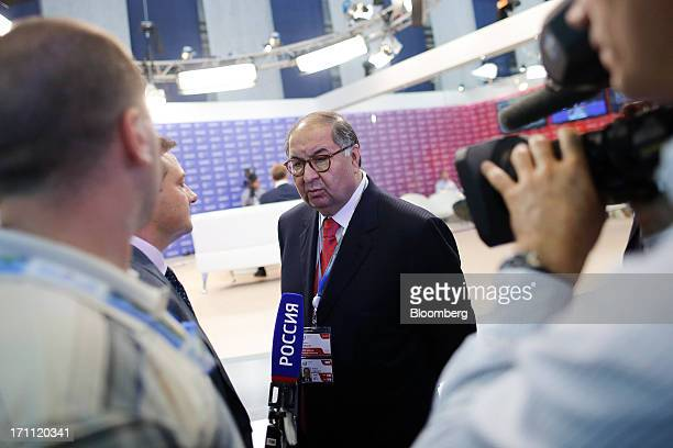 Alisher Usmanov Russian billionaire and owner of USM Holdings Ltd speaks to a Russian television crew on day two of the St Petersburg International...