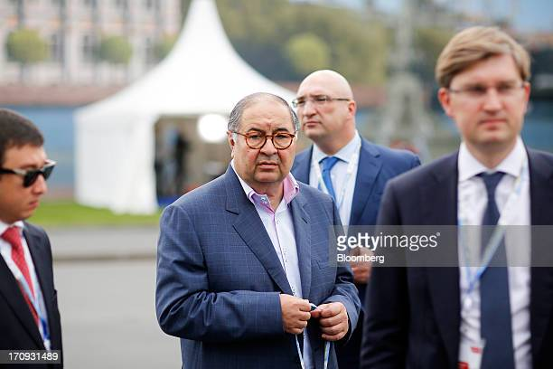 Alisher Usmanov Russian billionaire owner of USM Holdings Ltd center leaves following a Bloomberg Television interview on the opening day of the St...