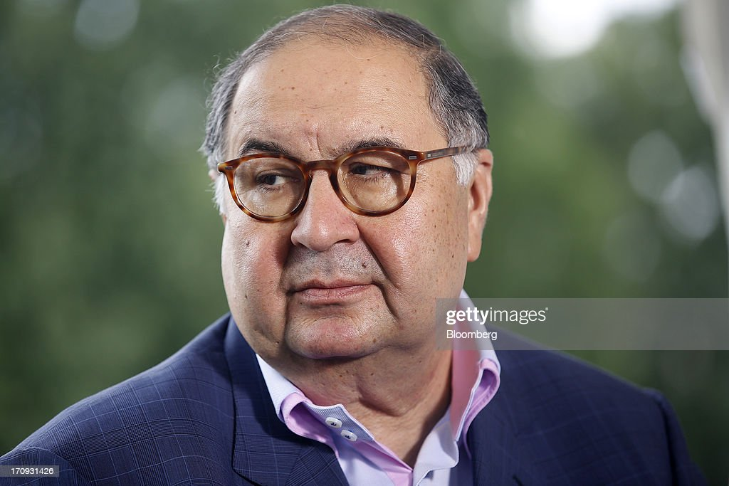 <a gi-track='captionPersonalityLinkClicked' href=/galleries/search?phrase=Alisher+Usmanov&family=editorial&specificpeople=5595265 ng-click='$event.stopPropagation()'>Alisher Usmanov</a>, Russian billionaire owner of USM Holdings Ltd., pauses during a Bloomberg Television interview on the opening day of the St. Petersburg International Economic Forum 2013 (SPIEF) in St. Petersburg, Russia, on Thursday, June 20, 2013. Russian consumer spending probably eased and investment shrank at the fastest pace since 2011, adding to evidence the $2 trillion economy is stalling. Photographer: Simon Dawson/Bloomberg via Getty Images