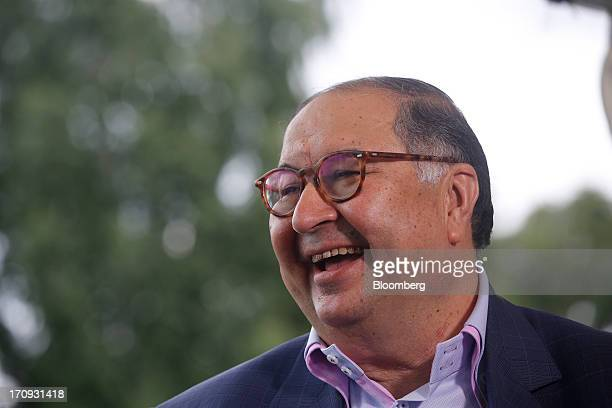 Alisher Usmanov Russian billionaire owner of USM Holdings Ltd reacts during a Bloomberg Television interview on the opening day of the St Petersburg...
