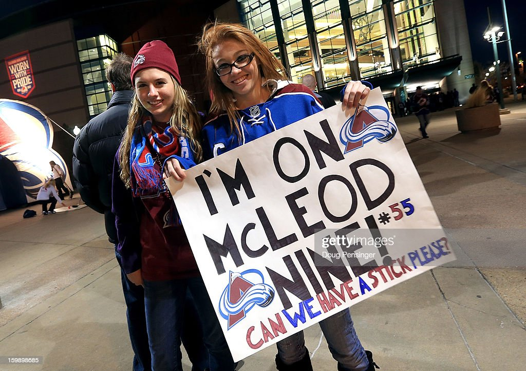 Alisia Knoll and Kyla Griest display a sign in support of Cody McLeod #55 of the Colorado Avalanche as they stand in line waiting for the gates to open as the Avalanche host the Los Angeles Kings at the Pepsi Center on January 22, 2013 in Denver, Colorado.