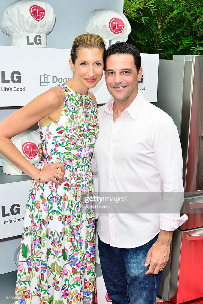 Alisia Reiner and David Alan Basche attend LG and Chef Sandra Lee Host LG Junior Chef Academy to celebrate the launch of the Door-in-Door Refrigerator with CustomChill, Benefiting No Kid Hungry at The Washbow on July 15, 2014 in Culver City, California.