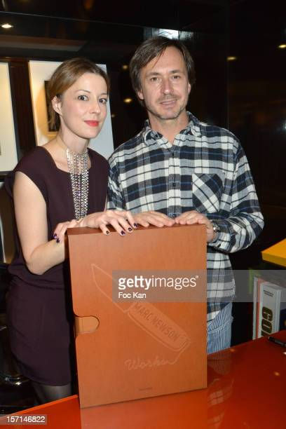 Alison Castle and Marc Newson attend the Marc Newson book launch cocktail at the Taschen Store on November 28 2012 in Paris France