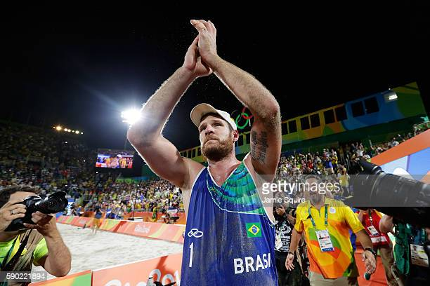 Alison Cerutti of Brazil playing with Bruno Oscar Schmidt of Brazil celebrates after beating Alexander Brouwer and Robert Meeuwsen of Netherlands...