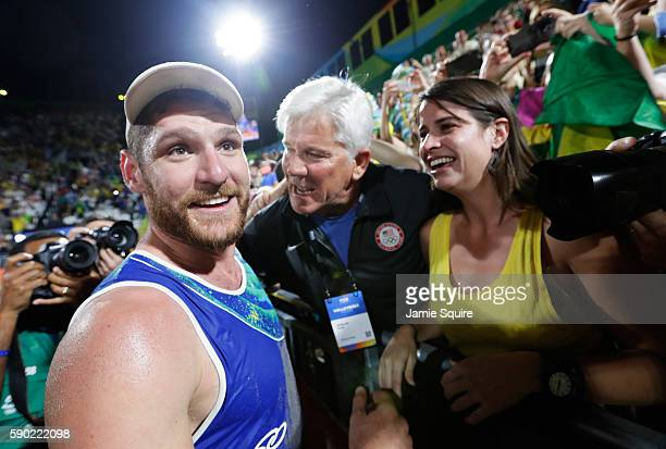 Alison Cerutti of Brazil playing with Bruno Oscar Schmidt of Brazil celebrates with his girlfriend after beating Alexander Brouwer and Robert...
