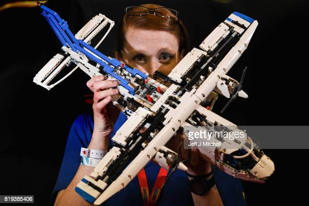 Alison Clayton holds a Lego plane during Bricklive at the Scottish Exhibition and Conference Center on July 20 2017 in Glasgow Scotland Europe's...