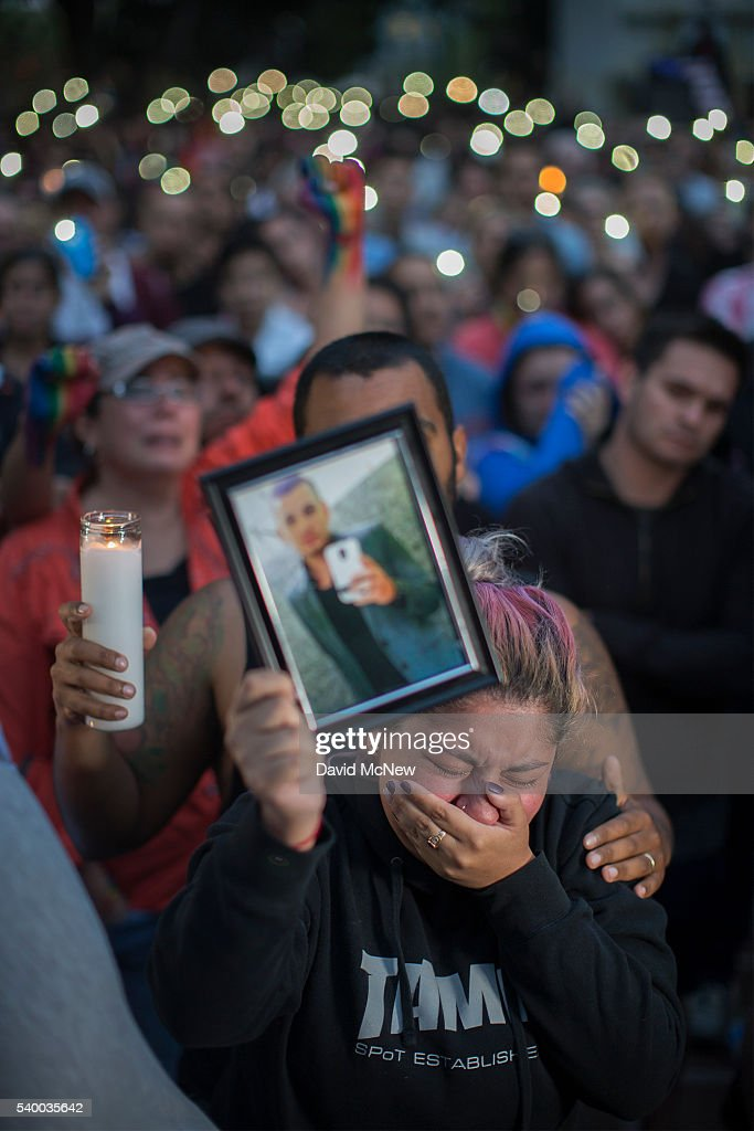 Alison Cosio holds a photo of her friend Christopher Sanfeliz, who was killed at the Pulse nightclub, during a vigil for the worst mass shooing in United States history on June 13, 2016 in Los Angeles, United States. A gunman killed 49 people and wounded 53 others at a gay nightclub in Orlando, Florida early yesterday morning before suspect Omar Mateen also died on-scene.