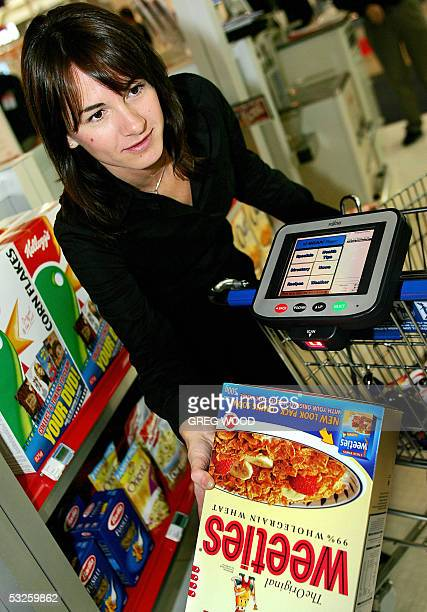 Alison Drennan scans a cereal box barcode into the computer of Fujitsu's new Wireless Shopping Trolley at the Retail Business Technology Show in...