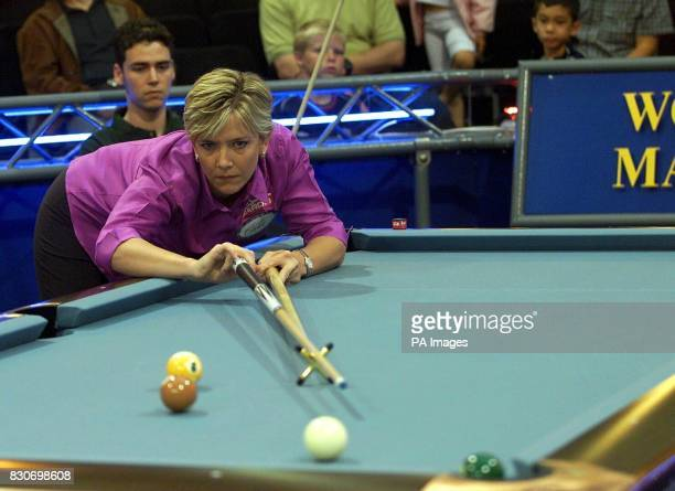 Alison Fisher formerly of Brighton England now resident in Charlotte USA hits her break shot against Australia's Quinten Hahn during the World Pool...