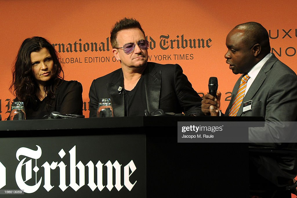 Alison Hewson, Bono and Erastus Kibugu of TechnoServe speak during the third day of the 2012 International Herald Tribune's Luxury Business Conference held at Rome Cavalieri on November 16, 2012 in Rome, Italy. The 12th annual IHT Luxury conference is the premier meeting point for the luxury industry. 500 delegates from 30 countries have gathered in Rome to hear from the world's most inspirational fashion designers and luxury business leaders.