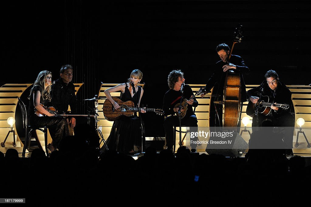 Alison Krauss, Eric Darken, Taylor Swift, Sam Bush, Edger Miller and Vince Gill perform during the 47th annual CMA awards at the Bridgestone Arena on November 6, 2013 in Nashville, Tennessee.