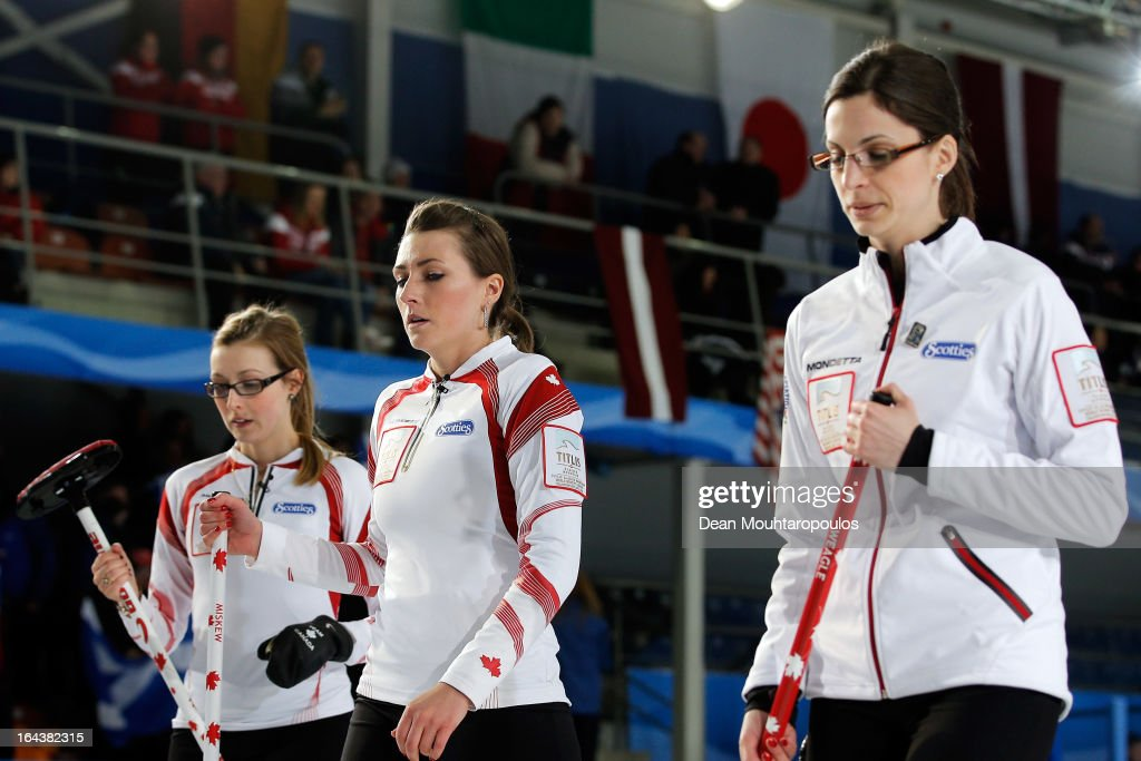 Alison Kreviazuk (L), Lisa Weagle (R) and Emma Miskew (C) of Canada look dejected after defeat in the Semi Final match between Scotland and Canada on Day 8 of the Titlis Glacier Mountain World Women's Curling Championship at the Volvo Sports Centre on March 23, 2013 in Riga, Latvia.