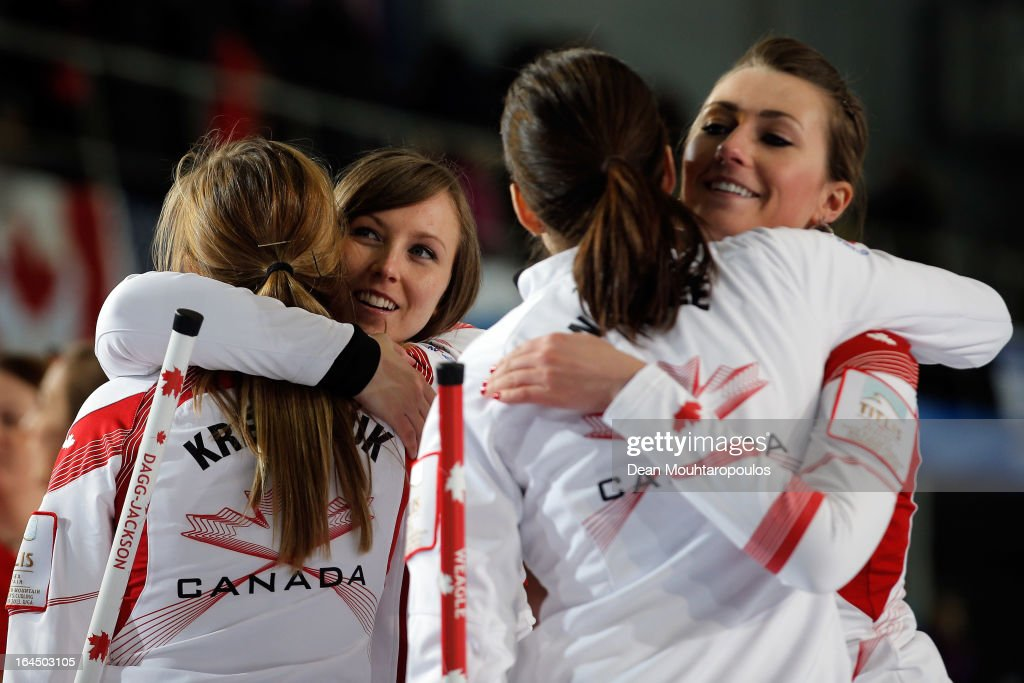 Alison Kreviazuk, Rachel Homan, Lisa Weagle and Emma Miskew of Canada celebrate winning the Bronze medal match between USA and Canada on Day 9 of the Titlis Glacier Mountain World Women's Curling Championship at the Volvo Sports Centre on March 24, 2013 in Riga, Latvia.