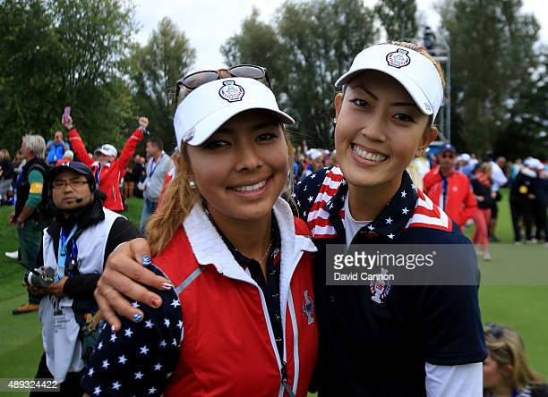 Alison Lee and Michelle Wie celebrate during the final day singles matches in the 2015 Solheim Cup at St LeonRot Golf Club on September 20 2015 in...
