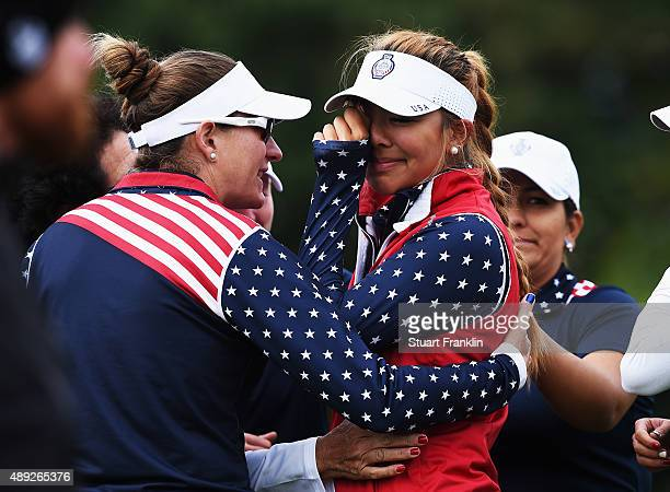 Alison Lee of team USA cries shortly afterwards she was told that her short putt on the 17th hole had not been conceeded and thus loosing the hole to...