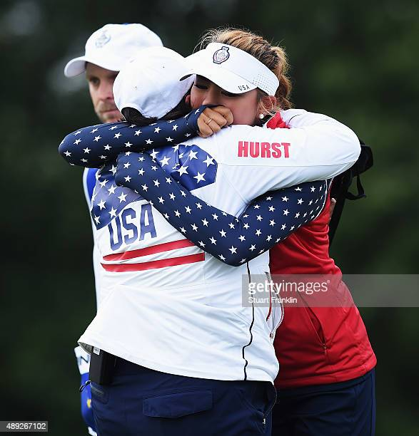 Alison Lee of team USA is comforted by Pat Hurst shortly afterwards she was told that her short putt on the 17th hole had not been conceeded and thus...