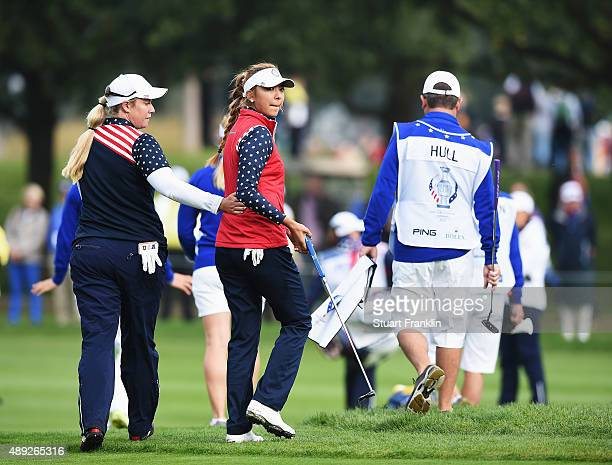 Alison Lee of team USA looks back after being told that her putt was not conceeded on the 17th green and thus loosing the hole Playing partner...