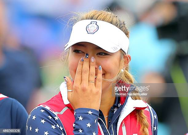Alison Lee of the United States crying on the 18th green after her error in picking up her ball on the 17th hole before it had been conceded by her...