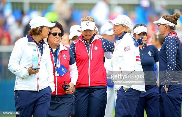 Alison Lee of the United States is comforted by Juli Inkster the United States Team Captain Nancy Lopez and Wendy Ward United States assistant...