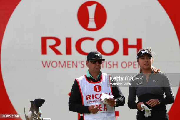 Alison Lee of the United States looks on with her caddie during a proam round prior to the Ricoh Women's British Open at Kingsbarns Golf Links on...