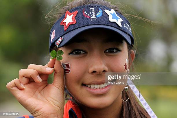Alison Lee of the USA poses with a 4 leaf clover during the foursomes on day one of the 2011 PING Junior Solheim Cup at Knightsbrook Hotel and Golf...