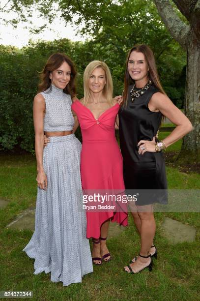 Alison Loehnis Jessica Seinfeld and Brooke Shields attend The GOOD Foundation's Hamptons Summer Dinner cohosted by NETAPORTER on July 29 2017 in East...