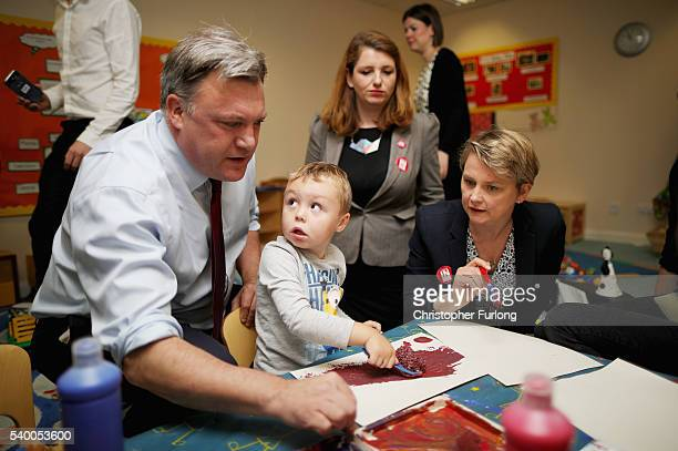 Alison Mcgovern Mp looks on as Yvette Cooper MP and her husband and former shadow chancellor Ed Balls paint with children during a Vote Remain...