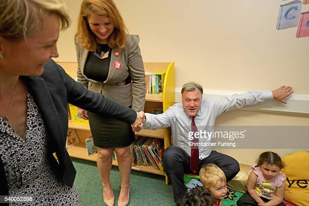Alison McGovern MP looks on as Yvette Cooper MP gives a helping hand to her husband and former shadow chancellor Ed Balls as he gets up from a story...