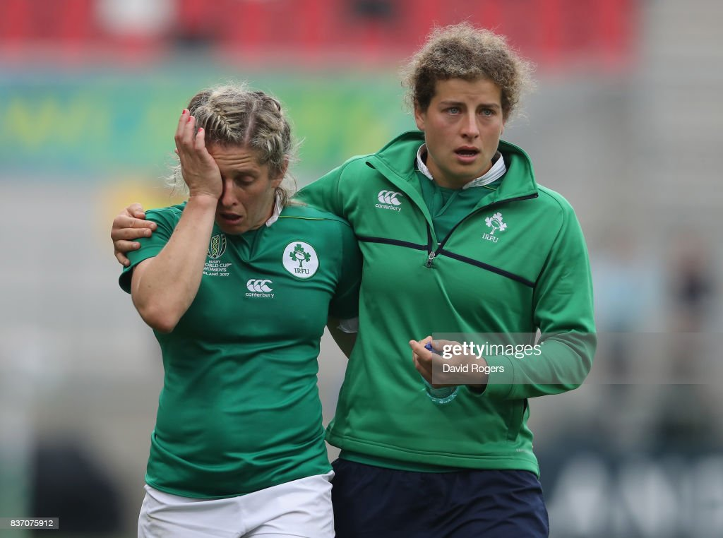 Alison Miller (L) of Ireland is conforted by a team mate after their defeat during the Women's Rugby World Cup 2017 match between Ireland and Australia at the Kingspan Stadium on August 22, 2017 in Belfast, United Kingdom.