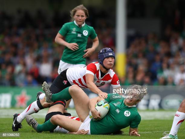 Alison Miller of Ireland is tackled by Minori Yamamoto of Japan during the Women's Rugby World Cup 2017 match between Ireland and Japan on August 13...