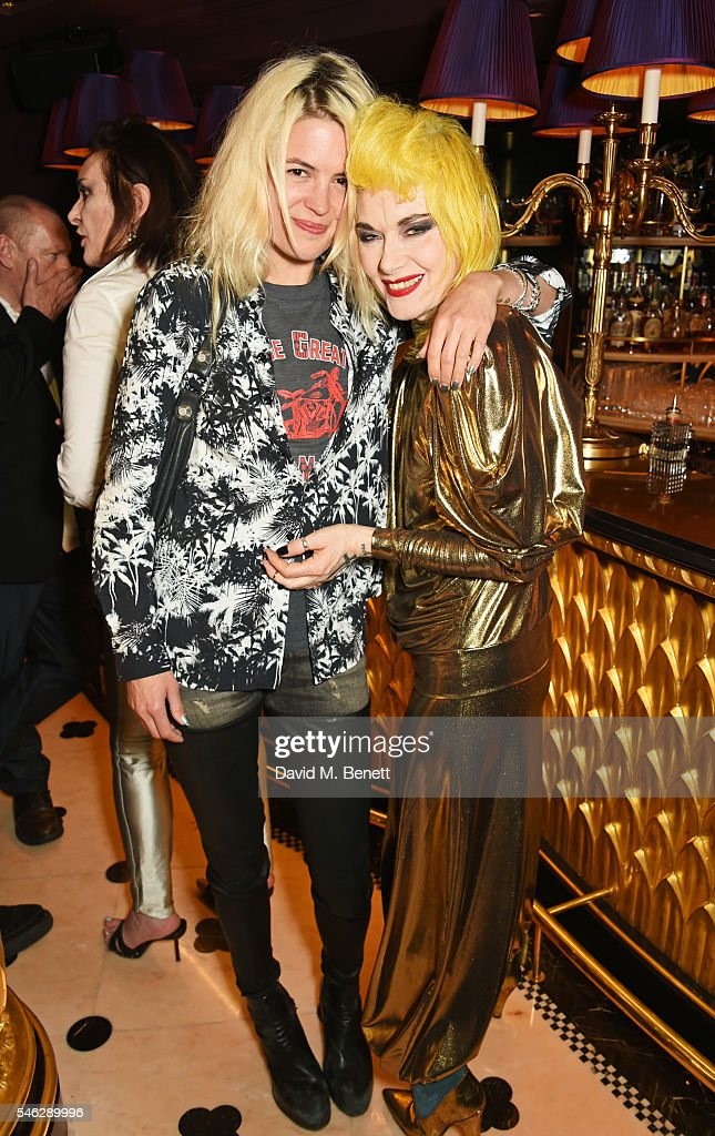 Alison Mosshart (L) and Pam Hogg pose in Club Chinois at a party to celebrate Pam Hogg's honorary doctorate from Glasgow University in association with Perrier-Jouet on July 11, 2016 in London, England.