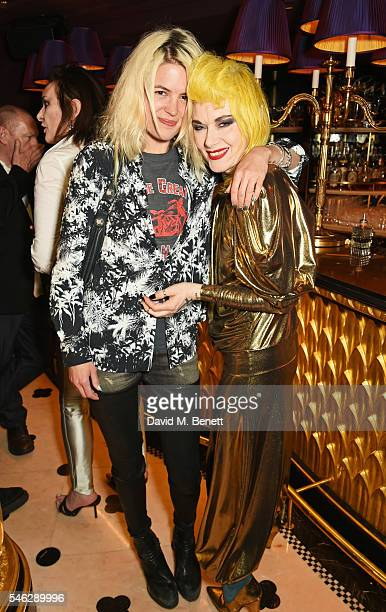 Alison Mosshart and Pam Hogg pose in Club Chinois at a party to celebrate Pam Hogg's honorary doctorate from Glasgow University in association with...