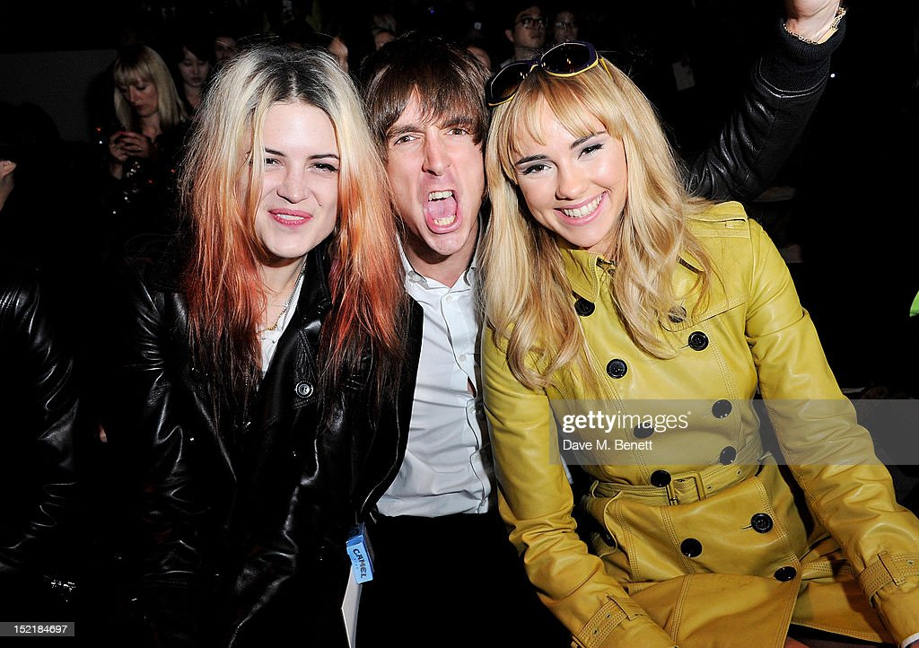 <a gi-track='captionPersonalityLinkClicked' href=/galleries/search?phrase=Alison+Mosshart&family=editorial&specificpeople=226602 ng-click='$event.stopPropagation()'>Alison Mosshart</a>, <a gi-track='captionPersonalityLinkClicked' href=/galleries/search?phrase=Miles+Kane&family=editorial&specificpeople=4860678 ng-click='$event.stopPropagation()'>Miles Kane</a> and Suki Waterhouse arrive at the Burberry Spring Summer 2013 Womenswear Show during London Fashion Week on September 17, 2012 in London, United Kingdom.