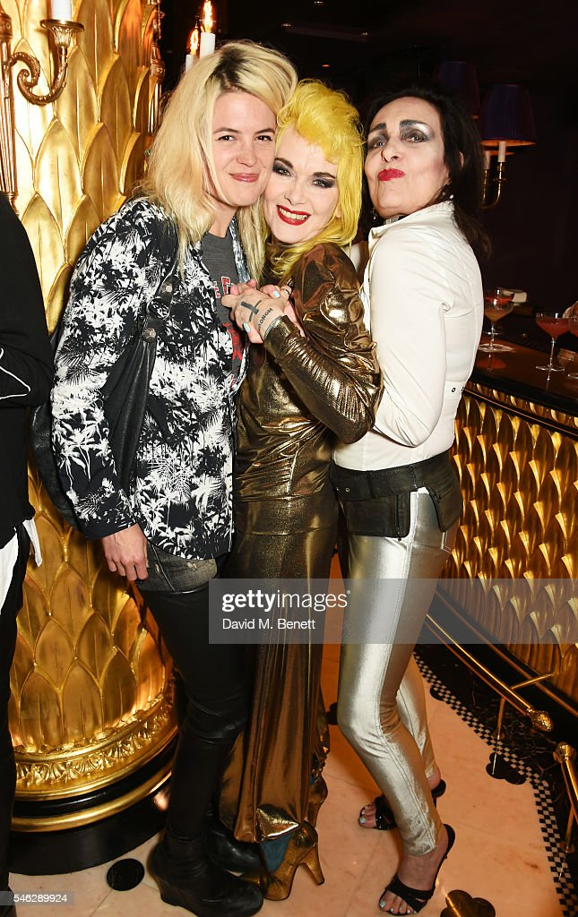 Alison Mosshart, Pam Hogg and Siouxsie Sioux pose in Club Chinois at a party to celebrate Pam Hogg's honorary doctorate from Glasgow University in association with Perrier-Jouet on July 11, 2016 in London, England.