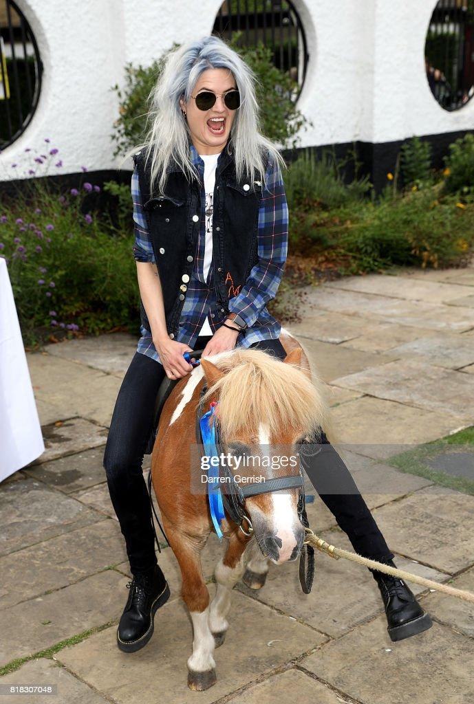 Alison Mosshart rides Freddie the Shetland pony at the J Brand x Bella Freud garden tea party on July 18, 2017 in London, England.