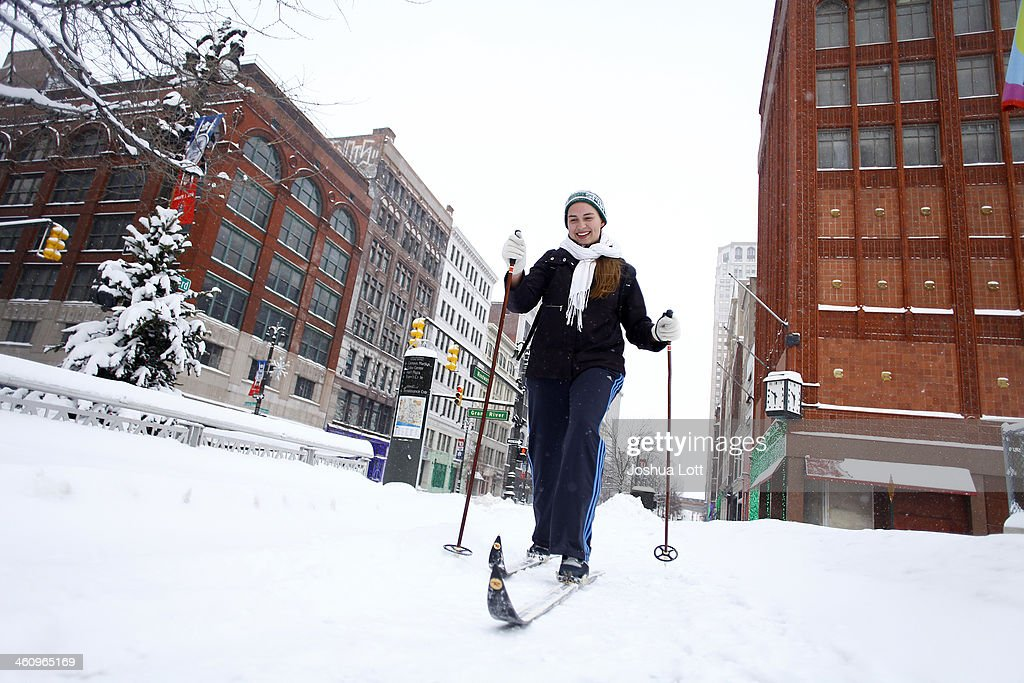Alison Mueller skies to work through several inches of snow along Woodward Avenue as the area deals with record breaking freezing weather January 6, 2014 in Detroit, Michigan. Michigan and most of the Midwest received their first major snow storm of 2014 last week and subzero temperatures are expected most of this week with wind-chill driving temperatures down to 50-70 degrees below zero. A 'polar vortex' weather pattern is bringing some of the coldest weather the U.S. has had in almost 20 years.