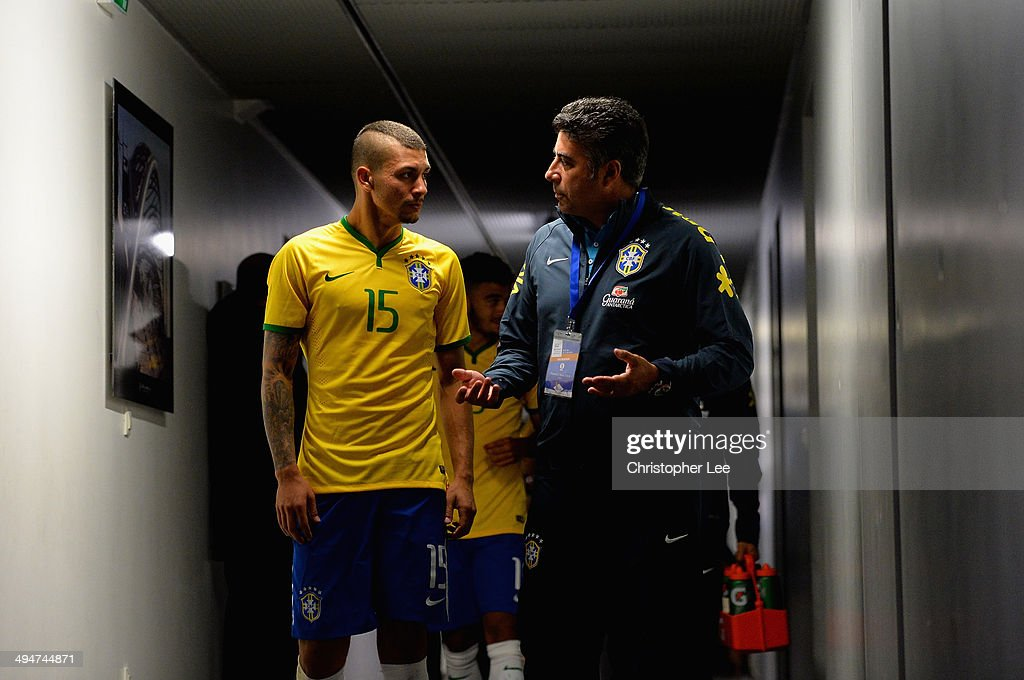 Alison of Brazil talks to head coach Alexandre Gallo during the Toulon Tournament Group B match between Brazil and Qatar at the Leo Legrange Stadium on May 30, 2014 in Toulon, France.