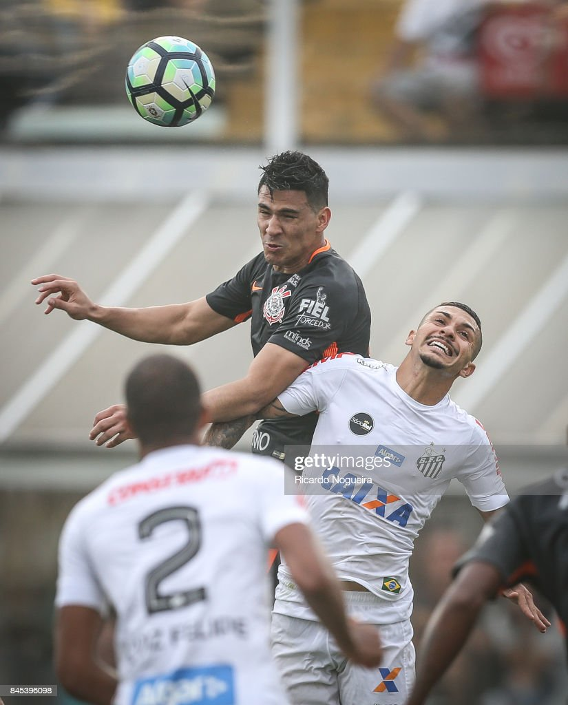 Alison #5 of Santos battles for the ball with Balbuena #4 of Corinthians during the match between Santos and Corinthians as a part of Campeonato Brasileiro 2017 at Vila Belmiro Stadium on September 10, 2017 in Santos, Brazil.