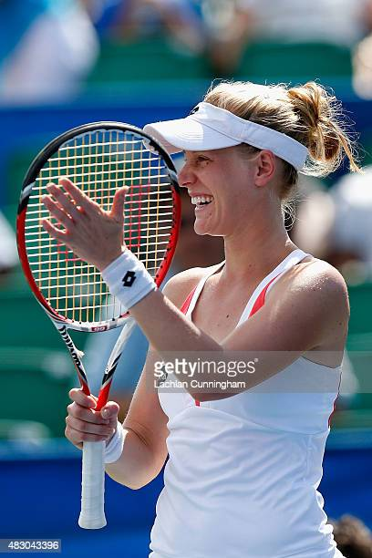 Alison Riske of the United States celebrates her win against Carla Suarez Navarro of Spain during day three of the Bank of the West Classic at the...