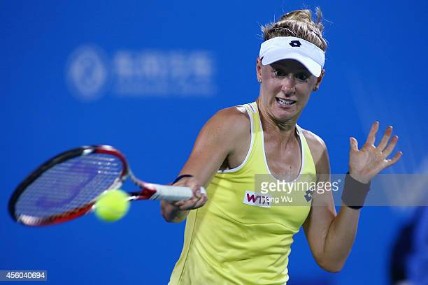 Alison Riske of the United States in action during her match against Eugenie Bouchard of Canada on day four of 2014 Dongfeng Motor Wuhan Open at...
