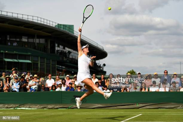 Alison Riske of the United States jumps for the ballduring the Ladies Singles first round match against Sloane Stephens of The United States on day...