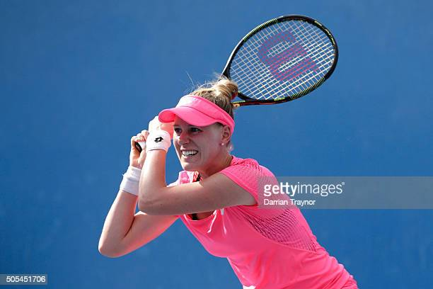 Alison Riske of the United States plays a backhand in her first round match against Belinda Bencic of Switzerland during day one of the 2016...