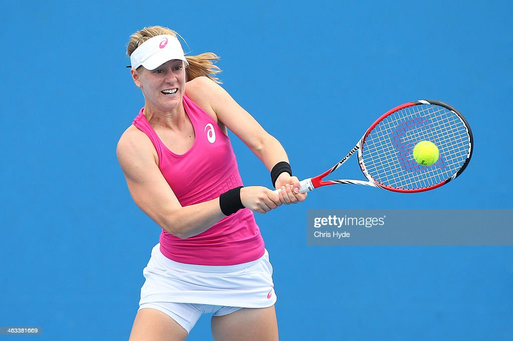 Alison Riske of the United States plays a backhand in her second round doubles match with Madison Keys of the United States against Kristina Mladenovic of France Flavia Pennetta of Italy during day six of the 2014 Australian Open at Melbourne Park on January 18, 2014 in Melbourne, Australia.